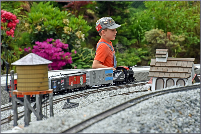 Junior member controls his garden railway train...!